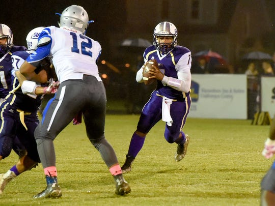 Waynesboro quarterback DaJuan Moore runs the football on a quarterback keep during a football game played in Waynesboro on Friday, Oct. 7, 2016.