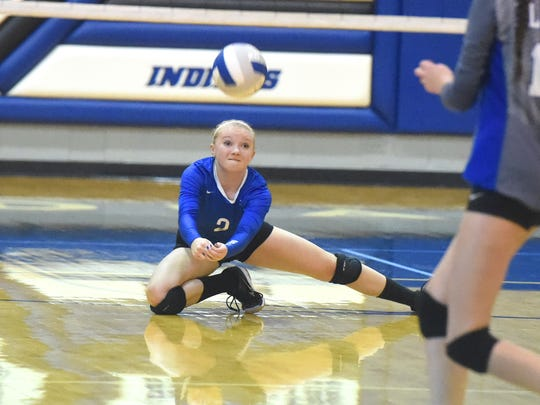 Fort Defiance's Ashley Humphries dive forward to bump the ball to keep it from hitting the floor during a volleyball match played in Fort Defiance on Tuesday, Oct. 11, 2016.