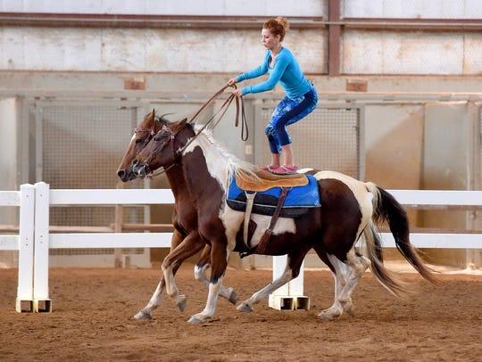 Fairland Ferguson demonstrates her skill at Roman riding,