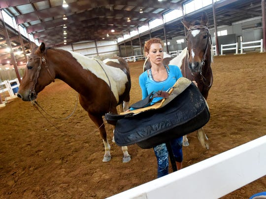 Fairland Ferguson unsaddles her pair of Roman riding horses, Hondo and Little Joe, at Virginia Horse Center in Lexington on Friday, Oct. 7, 2016.