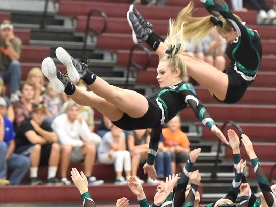 Wilson Memorial's competition cheerleading squad competes in the Conference 36 cheer competition in Stuarts Draft on Wednesday, Oct. 19, 2016.