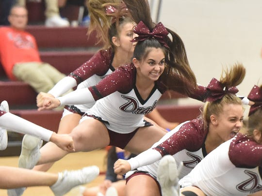 Stuarts Draft's competition cheerleading squad competes in the Conference 36 cheer competition in Stuarts Draft on Wednesday, Oct. 19, 2016.