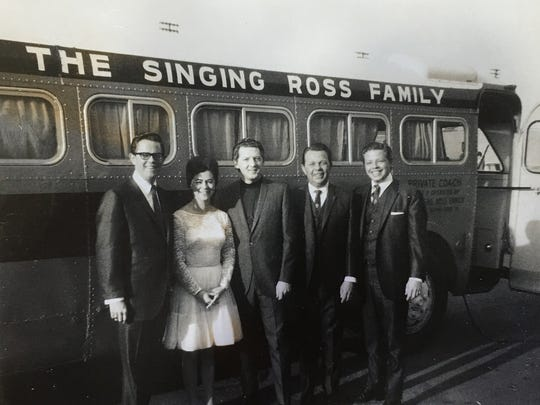 Jerry Ross, Peggy Fletcher, Jerry Lee Lewis, Bill Ross and Ray Ross standing outside their private coach.