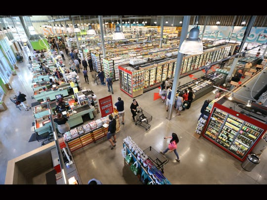 Shoppers made their way in the Whole Foods Market which opened Wednesday morning.