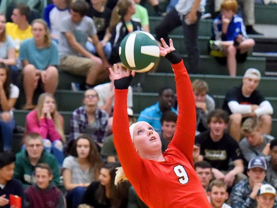 Riverheads Macey Snyder sets the ball during a volleyball match played in Fishersville on Thursday, Oct. 20, 2016.
