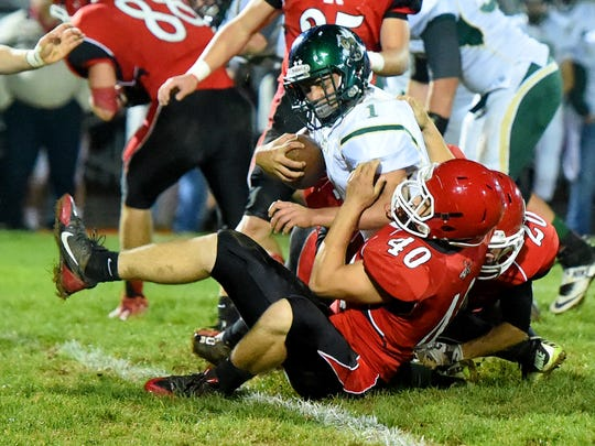 Wilson Memorial's Logan Leche is brought down by Riverheads' Harrison Schaefer during a football game played in Greenville on Friday, Oct. 21, 2016.