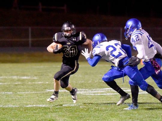 Buffalo Gap's Zach Ingram runs the football as Brunswick's
