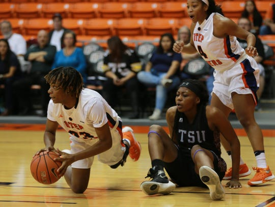 UTEP's Jakeira Ford, left, looks to pass after gaining