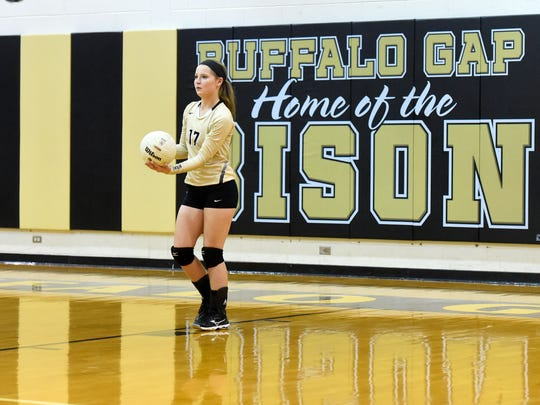 """The team's libero player, Buffalo Gap's Emily McComas warms up before a volleyball match played at Buffalo Gap on Oct. 27, 2016.  """"I didn't know anything about volleyball going into eighth-grade, but then made JV,"""" said McComas. """"I really feel like I've worked hard at learning positions and everything. ... And my freshman year, I made varsity."""""""