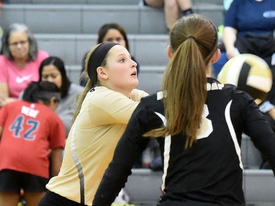 """Buffalo Gap's Emily McComas slips forward to pass the ball as she plays the libero position during a volleyball match played at Buffalo Gap on Oct. 27, 2016.  """"The libero position is very important,"""" said head coach Elizabeth Ashby. """"It's the person you're going to depend on to pull up everything on the back line."""""""
