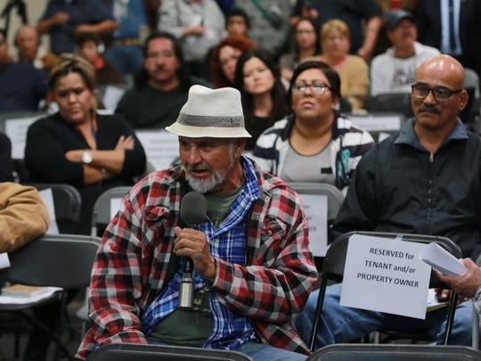 A businessman asks a question of Jose Carlos Villalva,