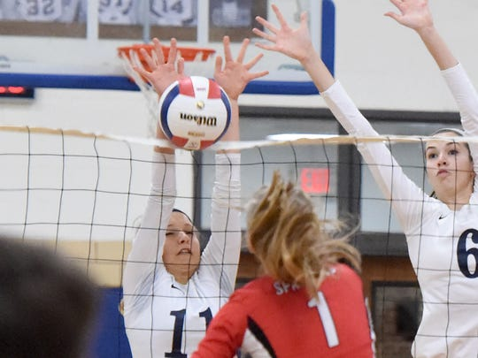 Robert E. Lee's Addison Keatts blocks a spike by Gile's Alyson Pennington at the net during a volleyball game played in Staunton on Tuesday, Nov. 15, 2016. Lee High beat Giles High School to win the 2A state semifinal match, 3-1.