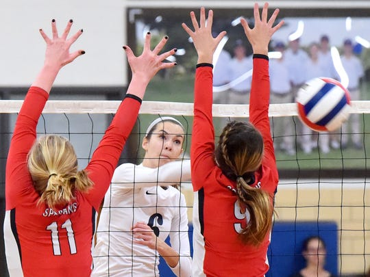 Robert E. Lee's Jennifer Williams spikes the ball past Gile's Jocelyn Midkiff and Hailey Kirk during a volleyball game played in Staunton on Tuesday, Nov. 15, 2016. Lee High beat Giles High School to win the 2A state semifinal match, 3-1.