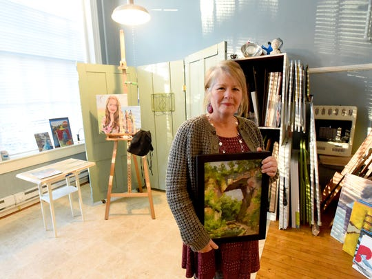 Owner and artist Donna Cruce Kocka of IagoArts holds