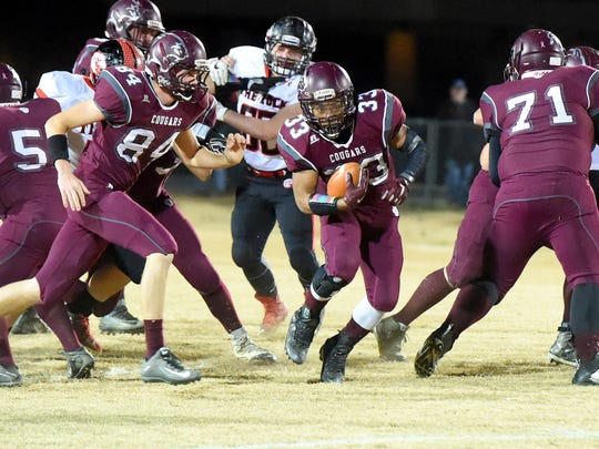 Stuarts Draft's Izzy Johnson finds a hole and runs the football through for more yards during a 2A East regional playoff football game played in Stuarts Draft on Friday, Nov. 25, 2016.
