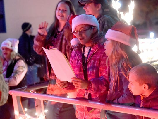 Parade participants sing to the crowd from a float during the Staunton Christmas Parade on Monday night, Nov. 28, 2016.