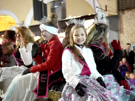 Pageant queens share a float during the Staunton Christmas Parade on Monday night, Nov. 28, 2016.