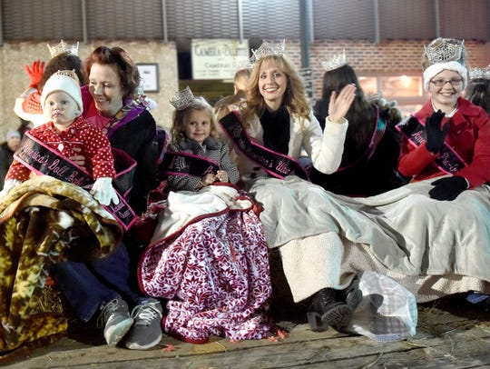 Pageant queens share a float during the Staunton Christmas