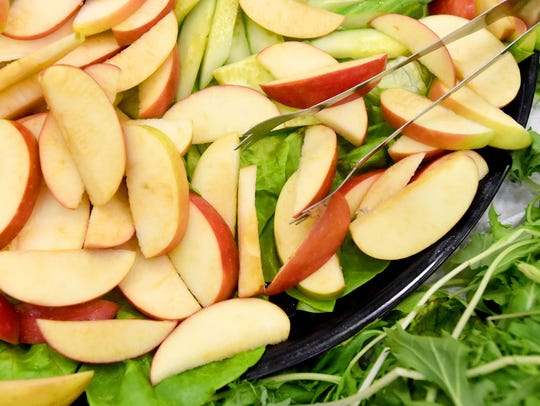Sliced locally grown apples available as a refreshment,