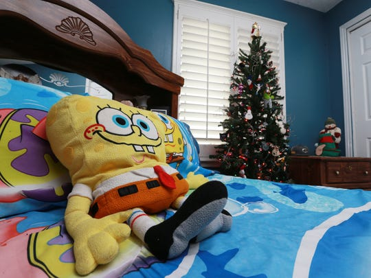 Sponge Bob characters decorate Suky Gonzalez's 11-year-old son's tree and bedroom.
