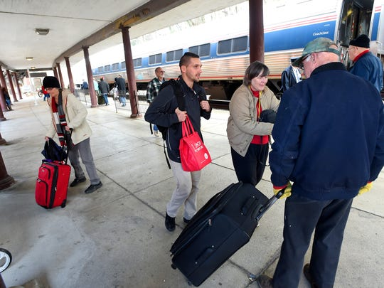 Home from Moody Theological Seminary in Chicago, Joey Waltz walks beside his mother, Martha Waltz, as father Dan Waltz pulls his suitcase. Joey traveled home for the holidays by way of Amtrak's eastbound Cardinal #50.