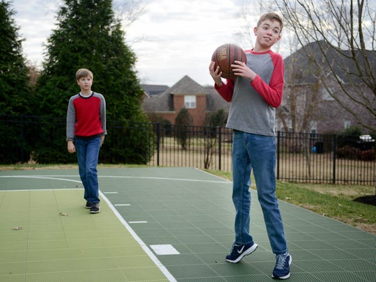 Alex Koch, right, plays basketball with his brother