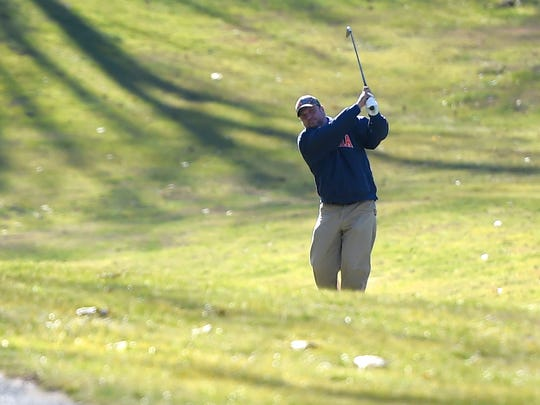 Scott Fitzgerald of Staunton watches the path of the ball he hit as he comes out of his swing during a round of golf on the golf course at Gypsy Hill Park on Wednesday, Dec. 28, 2016. Fitzgerald graduated Robert E. Lee High School in 1987 and remembers when the current high school first opened.