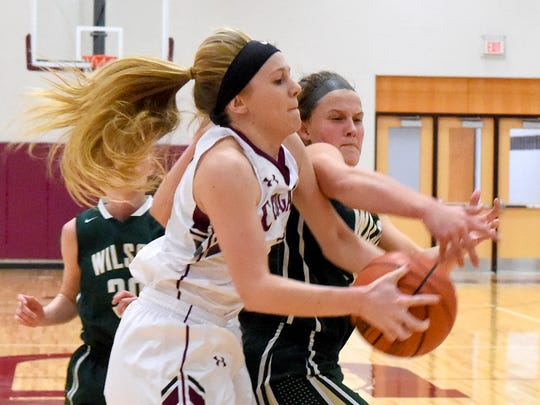 Wilson Memorial's Cheridan Hatfield (right) was the catalyst for Wilson Memorial's defense this year, often coming up with the big steal or shutting down the other team's best player.