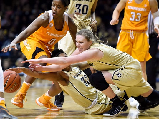Vanderbilt Commodores guard Christa Reed (33) and guard/forward Erin Whalen (21) dive for the ball past Tennessee Lady Volunteers guard Jordan Reynolds (0) during the fourth quarter at Memorial Gym in Nashville, Tenn., Thursday, Jan. 5, 2017.