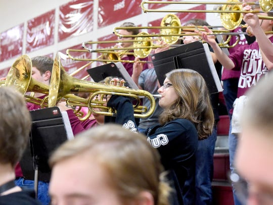 The brass section plays loud as the pep band for Stuarts