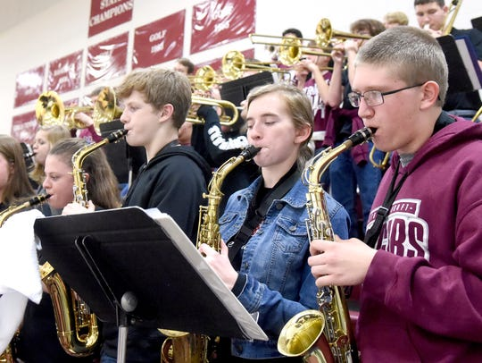 Saxophonists with Stuarts Draft's pep band rock their