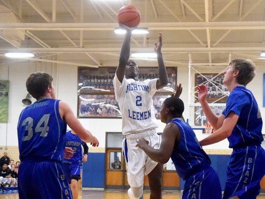 Robert E. Lee's Darius George shoots during a game