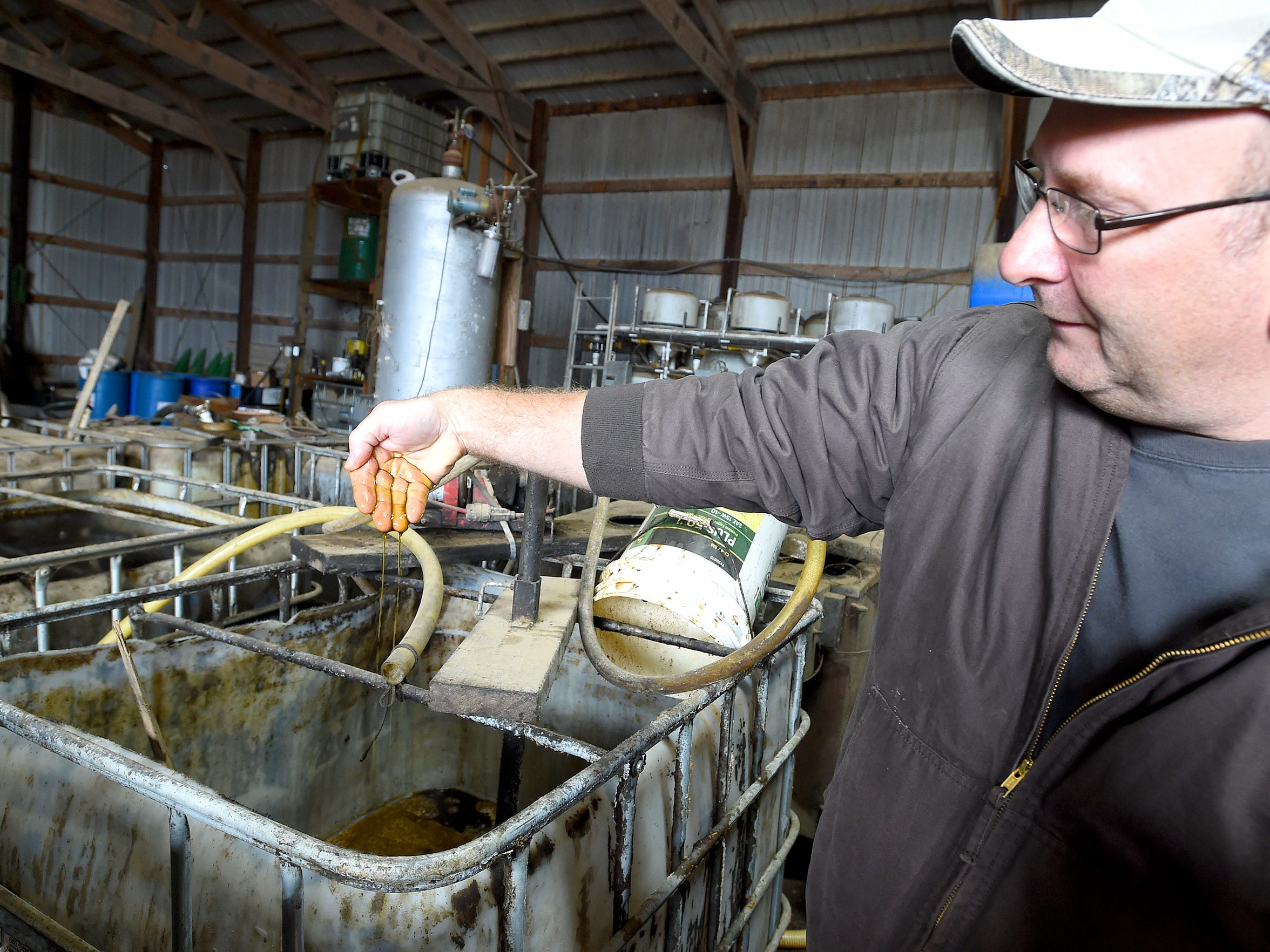 Glenn Rodes shows hemp seed oil harvested and collected