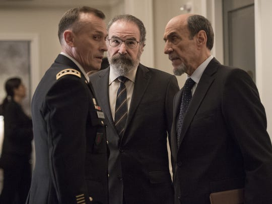 The CIA's Saul Berenson (Mandy Patinkin, center) and