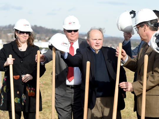 Chairman Tracy Pyles Jr. of the Augusta County Board of Supervisors grabs a helmet and then a golden shovel as he participates in the symbolic ground breaking for a new 108,000 square-foot facility being built by InterChange Group Inc during a ceremony at Mill Place Commerce Park in Verona on Thursday, Jan. 12, 2017.