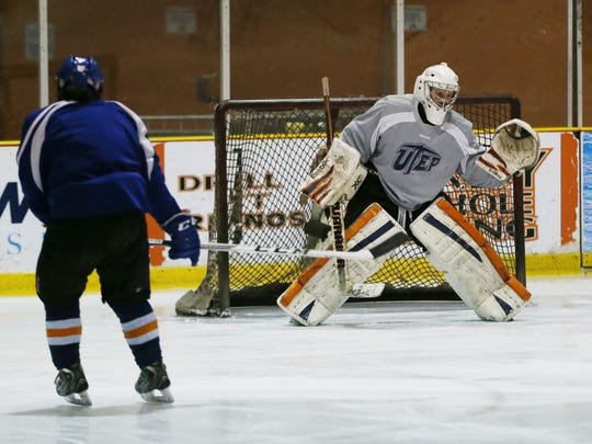 UTEP hockey team members go through drills Thursday.