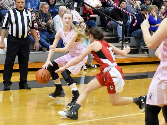 Buffalo Gap's Hannah Varner moves the ball as Riverheads' Christa Arehart guards during a game played in Swoope on Friday, Jan. 20, 2017.