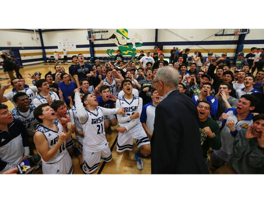 Cathedral players and students cheer Coach Tony Harper.