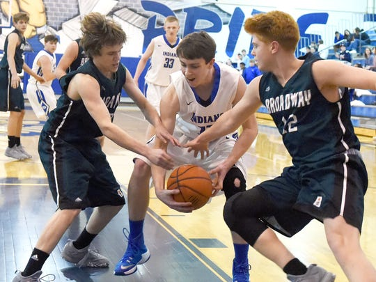 Fort Defiance's Zachary Eppard has to protect the ball as he finds himself between Jaxson Jameson and Jacob Terry during a Conference 29 quarterfinal game played in Fort Defiance on Saturday, Feb. 13, 2017.
