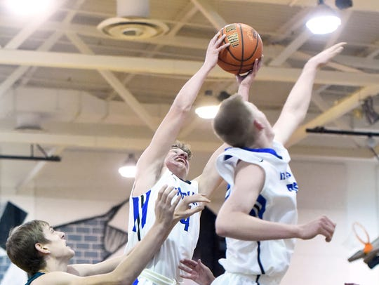 Fort Defiance's Jacob Jones comes away with the rebound