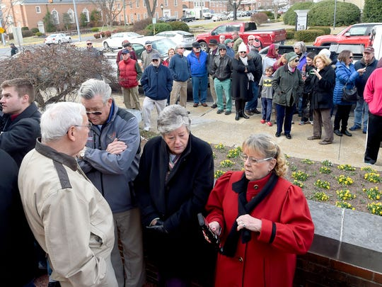 A crowd of onlookers gathers on both sides of Wayne Avenue in preparation to watch the auction of the Waynesboro Country Club held on the steps of the courthouse in Waynesboro on Wednesday, Feb. 15, 2017. Kenneth Bradley of Waynesboro won the auction with a bid of $891,000.