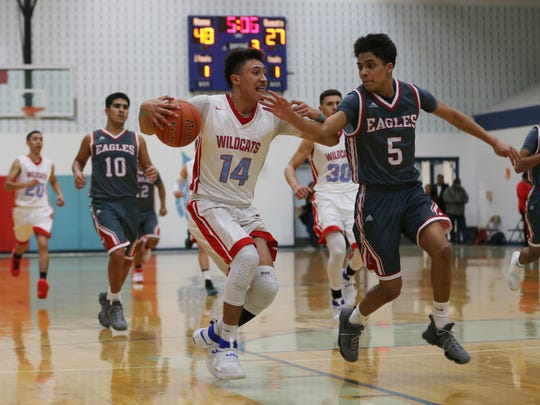 Anthony's Brayan Au drives to the basket Tuesday against Van Horn.