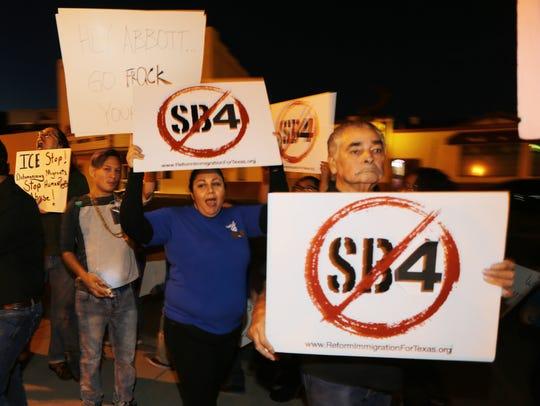 Protestors gathered outside the Blackstoe Event Center