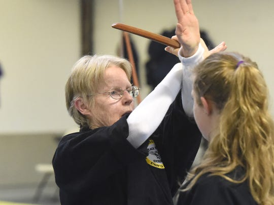 Collette Barry-Rec, a 2nd degree black belt in American Freestyle Karate, practices a self defense technique during class at the AFK studio in Staunton on Jan. 17, 2017. She also holds a red belt in Shotokan.