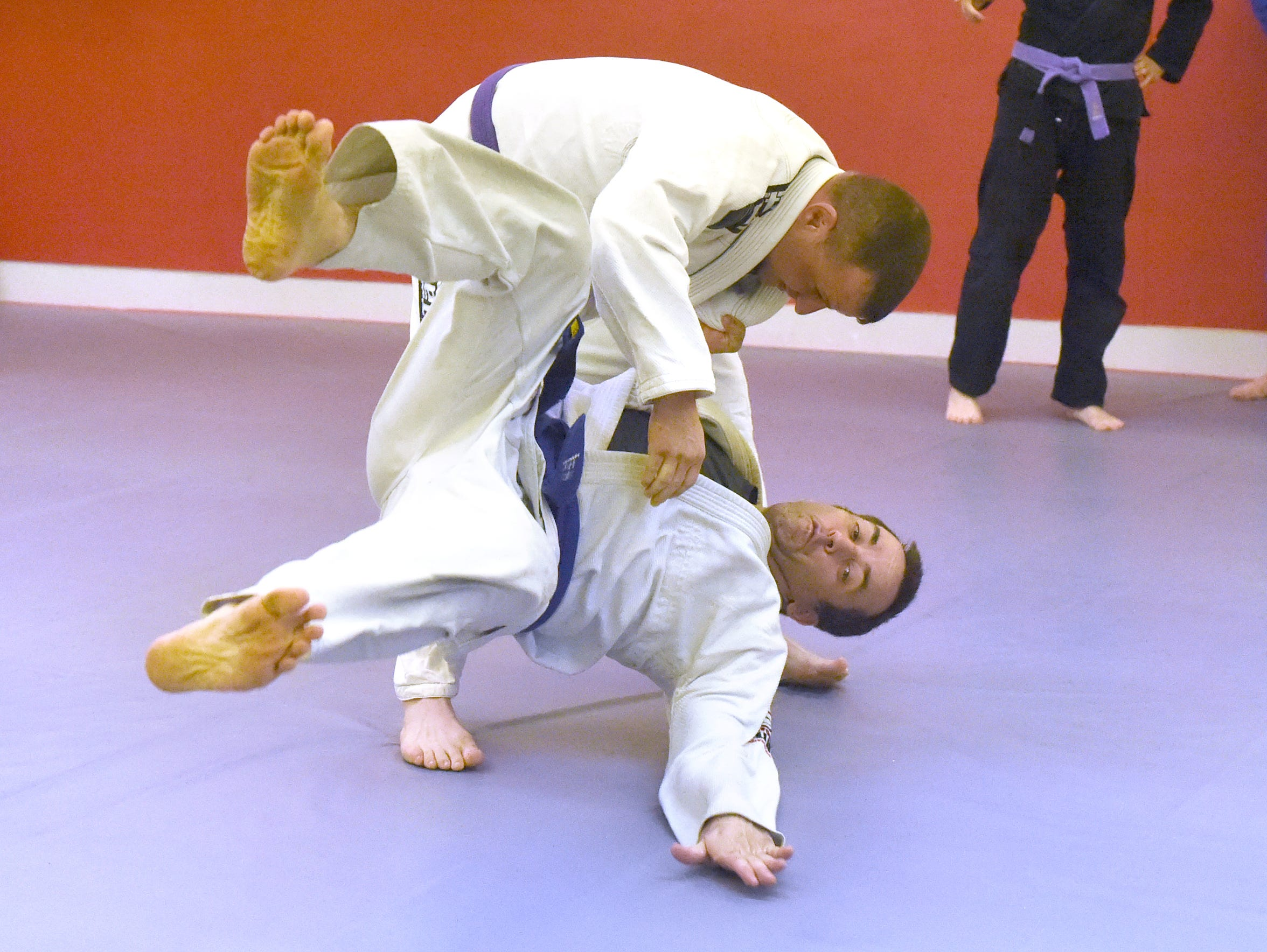 Brian Rose (top), a purple belt in Brazilian jiu-jitsu,