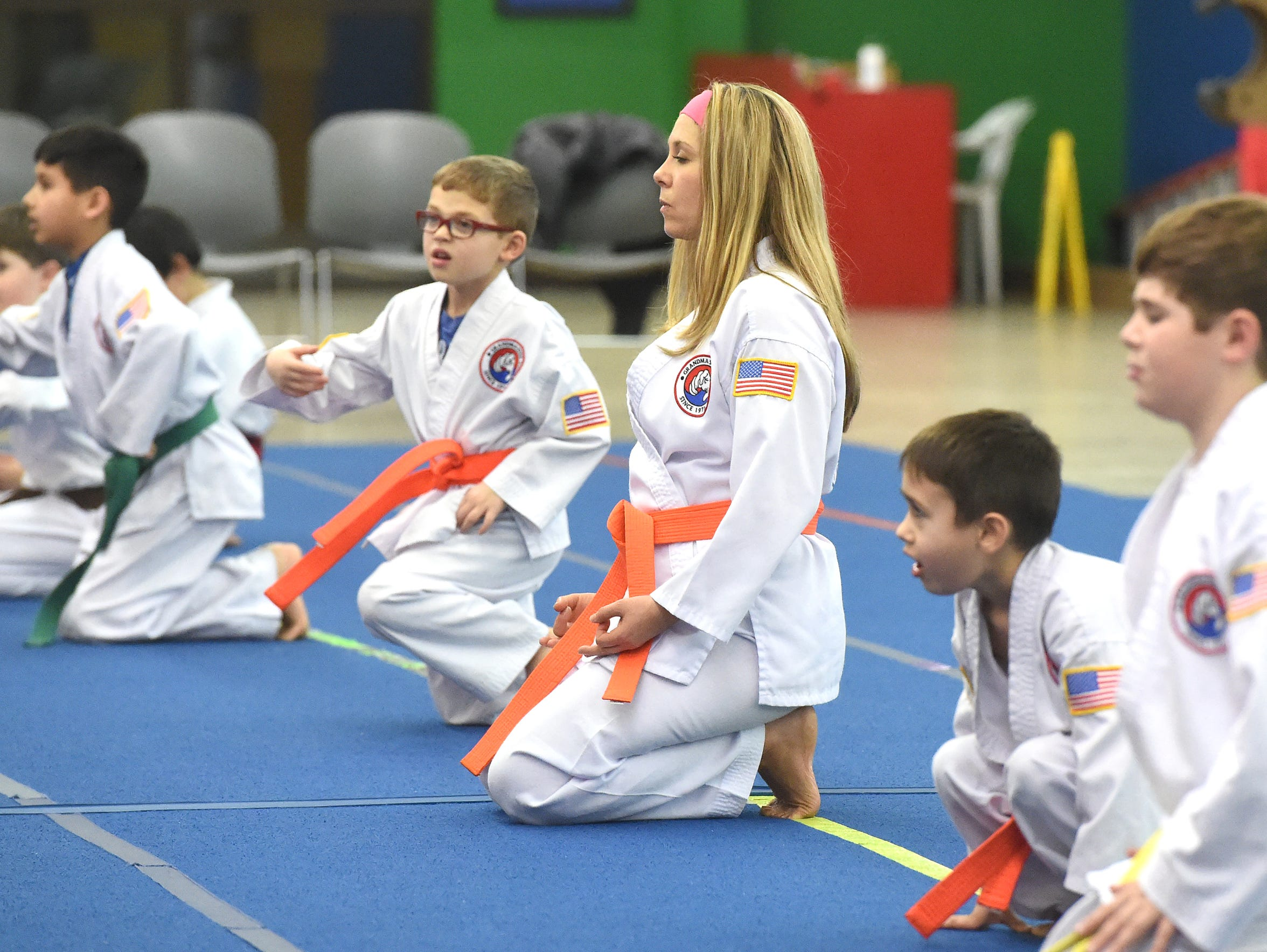 Crystal Heinz, an orange belt in Tae Kwon Do, quiets