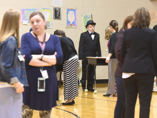 Visible through the crowd, fourth-grader Grayson Shaver portrays and answers questions about inventor Thomas Edison. Fourth-graders portrayed a variety of historical figures as part of a wax museum at Beverley Manor Elementary on Wednesday, Feb. 22, 2017.