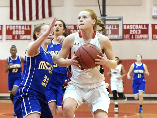 Riverheads' Blake Bartley heads to the basket with the ball as Mathew's Ellie Armistead guards during a Region 1A East regional quarterfinal basketball game played in Greenville on Wednesday, Feb. 22, 2017.