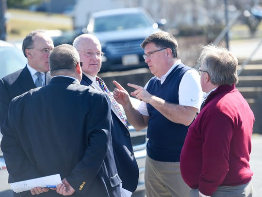 Representatives for both Fox Commercial Auctions and current owners of the Elliott Auto Group property that housed a Chevrolet and Cadillac dealership on Greenville Avenue take a moment to confer. The properties auction paused for several minutes after a bid for 1 million dollars was given on Thursday, Feb. 23, 2017.  Despite the bid, the property did not sell and was withdrawn.
