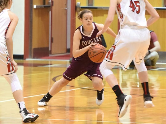 Stuarts Draft's Rachel Sauder moves the ball during a Region 2A East semifinal game played in Elkton on Thursday, Feb. 23, 2017.